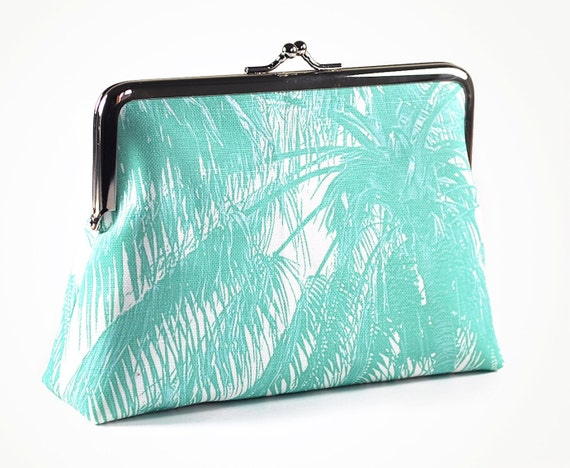 Green purse with palm tree