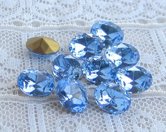 Vintage 8x6 mm Oval Swarovski Rhinestone Light Sapphire Blue