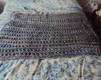 Hand Knit Baby or Lap Blanket in the color called Sugarplum (pink, purple, white and light green)