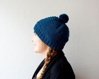 Hand knit pom pom hat in teal knitted beanie in soft wool blend warm and chunky