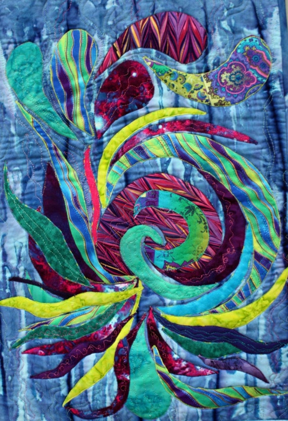 Wall decor abstract art wall hanging featuring a pieced spiral in purple blue teal lime green