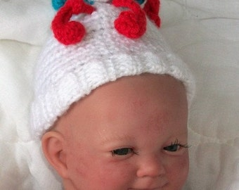 White Beanie...Boy or Girl Preemie...White, Red & Turquoise Squiggles on top...ADORABLE..READY to SHIP