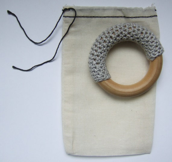 grey hand-crocheted teething ring in organic bag // newborn baby gift