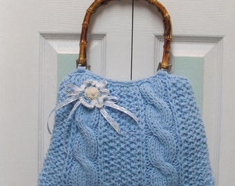 KNIT, LIGHT BLUE, handbag/purse, hand knitted in a cable stitch, fully lined, with wood bamboo handles and a crocheted floral