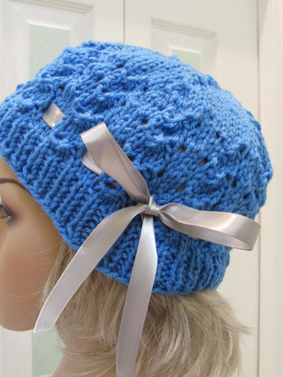 WINTER KNIT HAT: Pretty, bright blue, cloche/hat , hand knitted in a delicate shell pattern, with a satin grey ribbon tie.