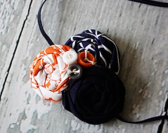Julius- orange and navy triple rosette headband