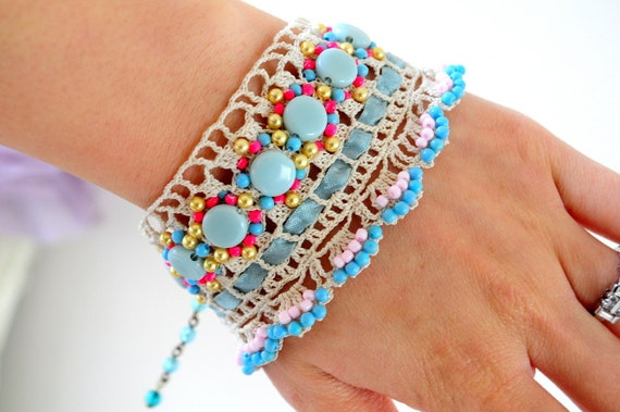 Robin eggs.. handmade Vintage lace bracelet with blue beads,ribbon and more