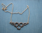 kissing snakes necklace - gold