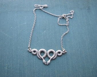 kissing snakes necklace - silver