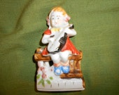 """Violin Girl In Red Dress Muscian """"Occupied Japan"""" Girl With Violin Or Mandolin Seated on Garden Bench Porcelain Figurine"""