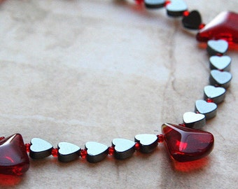 4th July Hematite Heart Necklace. Blood Red Glass Drops. Oxblood Swarovski Crystals. Black and Red. Metallic Gray. Aries Birthday Gift.