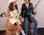 Country/Western Wedding Cake Topper with couple in cowboy hats and boots sitting on a bale of hay