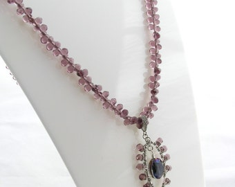Pendant necklace with purple crystal