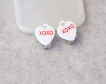 White XOXO Conversation Heart Clip On Foam Charm Earrings perfect for your little one for valentines day or just to say i love you
