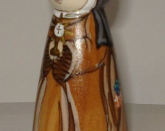 St. Clare wooden doll