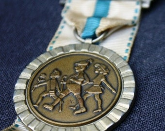 Family day out. Seventies souvenir medal.