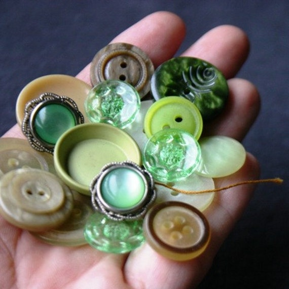 A handful of vintage green buttons
