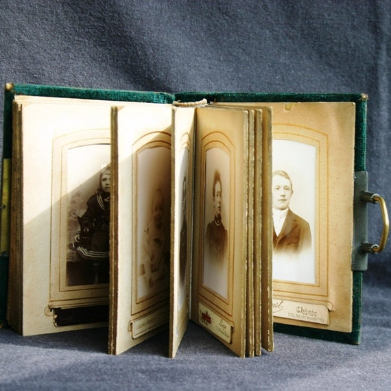 Family history. Antique cabinet photo album.