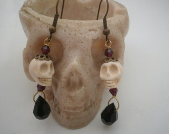 Earrings with white Skulls and Garnets