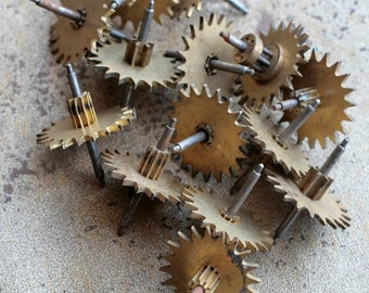 Vintage clock brass gears -- set of 17 -- D11