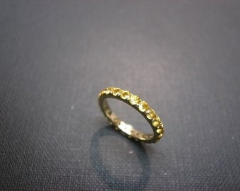 Eternity Ring with Yellow Sapphire in 14K Yellow Gold