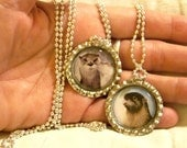 Kissing Otters, Bottlecap Pendant Necklace by Oneta