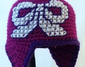 Magenta Baby Hat with Earflaps and Embroidered White Bow with Purple Trim