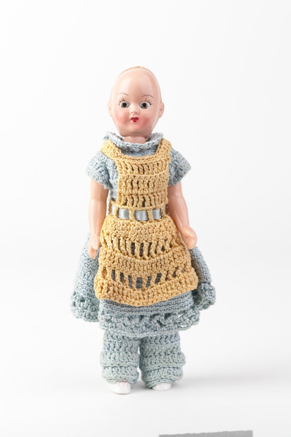 Mid Century Vintage Doll with hand crocheted clothing, hard plastic, sleeping eyes