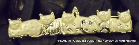 Adorable five kitty cat brooch. Price reduced