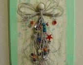 Angel in Hemp Cord and Beads on Wood