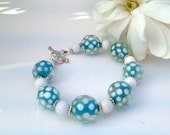 Summer lampwork and white onyx silver bracelet
