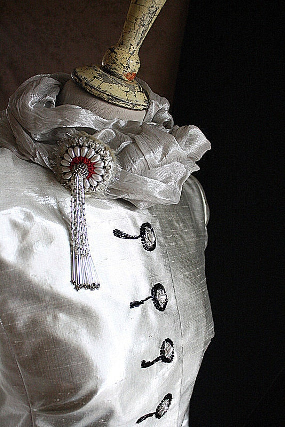 Natural silk taffeta hand embroidered jacket with a brooch