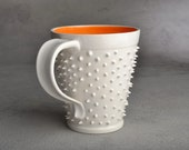 Spiky Mug Made To Order White and Orange Dangerously Spiky Mug by Symmetrical Pottery