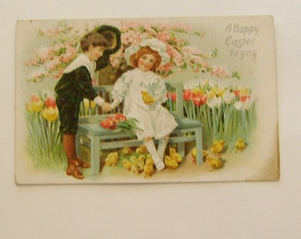 Antique Germany Easter postcard Edwardian boy and girl sitting on bench with chicks and tulips ephemera