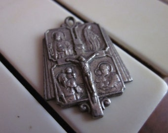 Crucifix Pendant with Jesus and Holy Family Images, IX