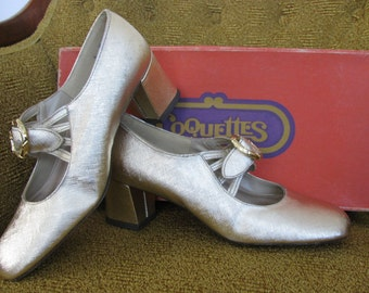 Womens Gold Pumps size 5 by Coquettes 60s era Never Worn Still in box