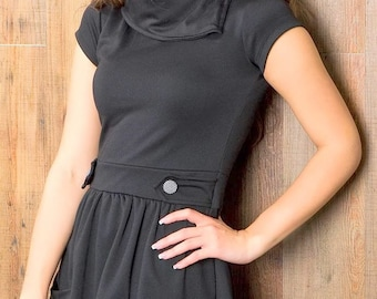 Beautiful black dress with pockets. Jersey. Short sleeve.