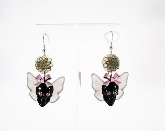 Glossy Jet Black Winged Skull Earrings with Crystal Eyes and Glittery Mum Accents