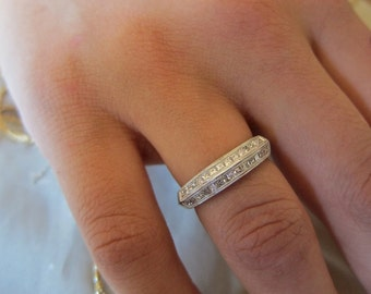 Platinum  princess cut wedding band.