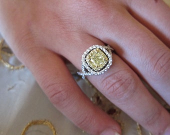 Fancy yellow diamond set on 18K engagement ring