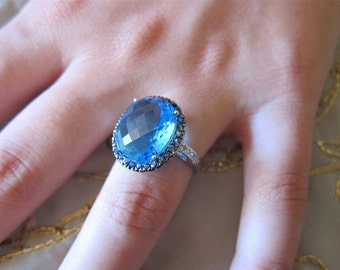 Blue Topaz with Sapphire and Diamonds on 14K white gold.