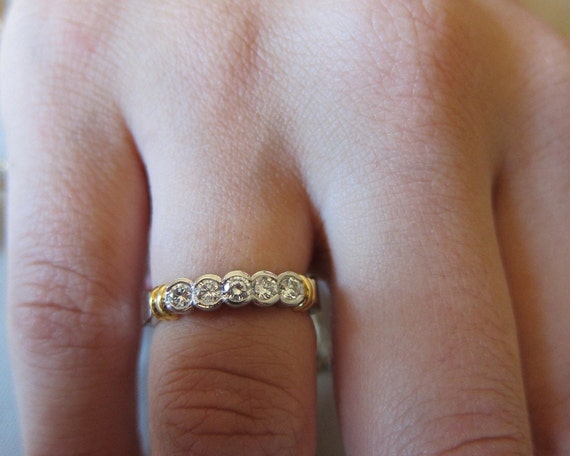 Half moon bezel set step down round diamonds wedding band