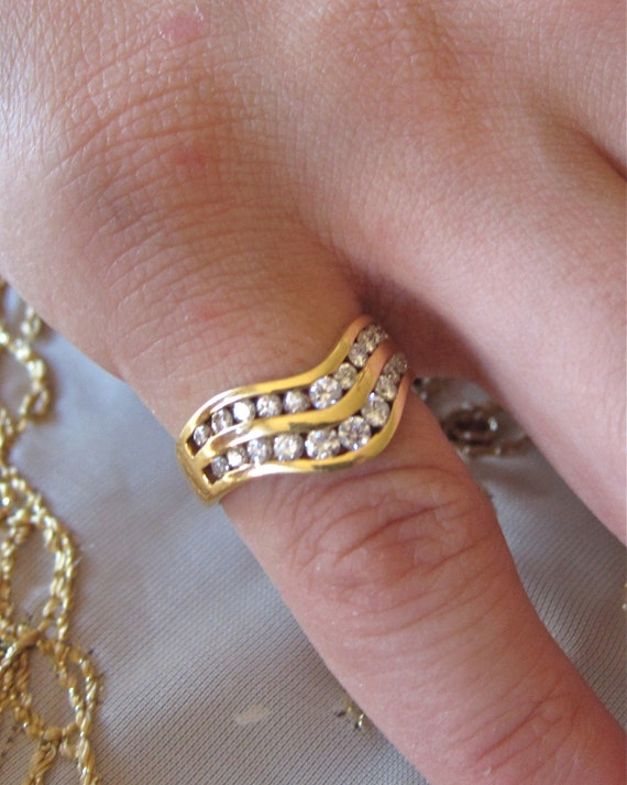 18K yellow gold channel set ring.
