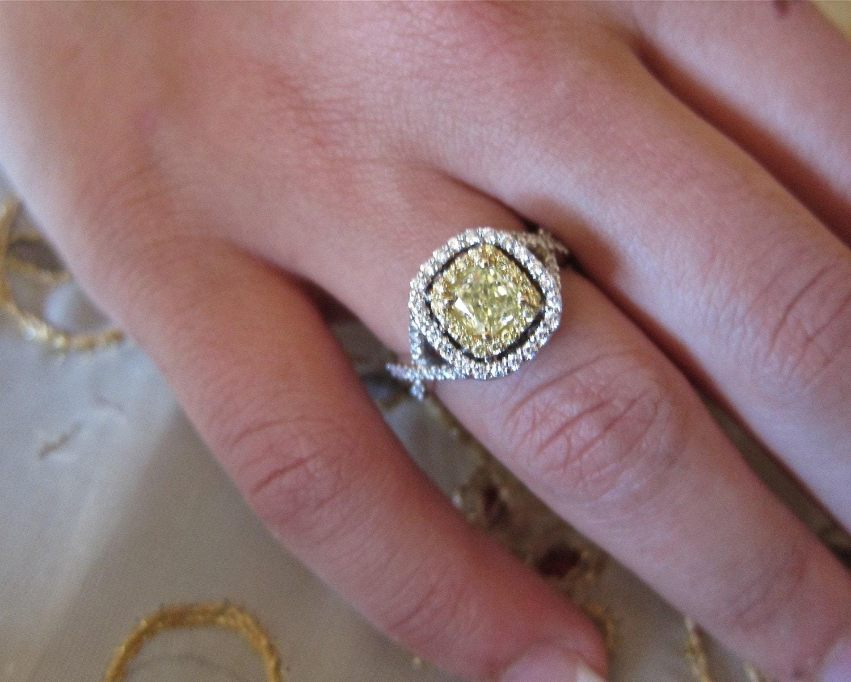 Fancy yellow diamond set on 18K engagement ring