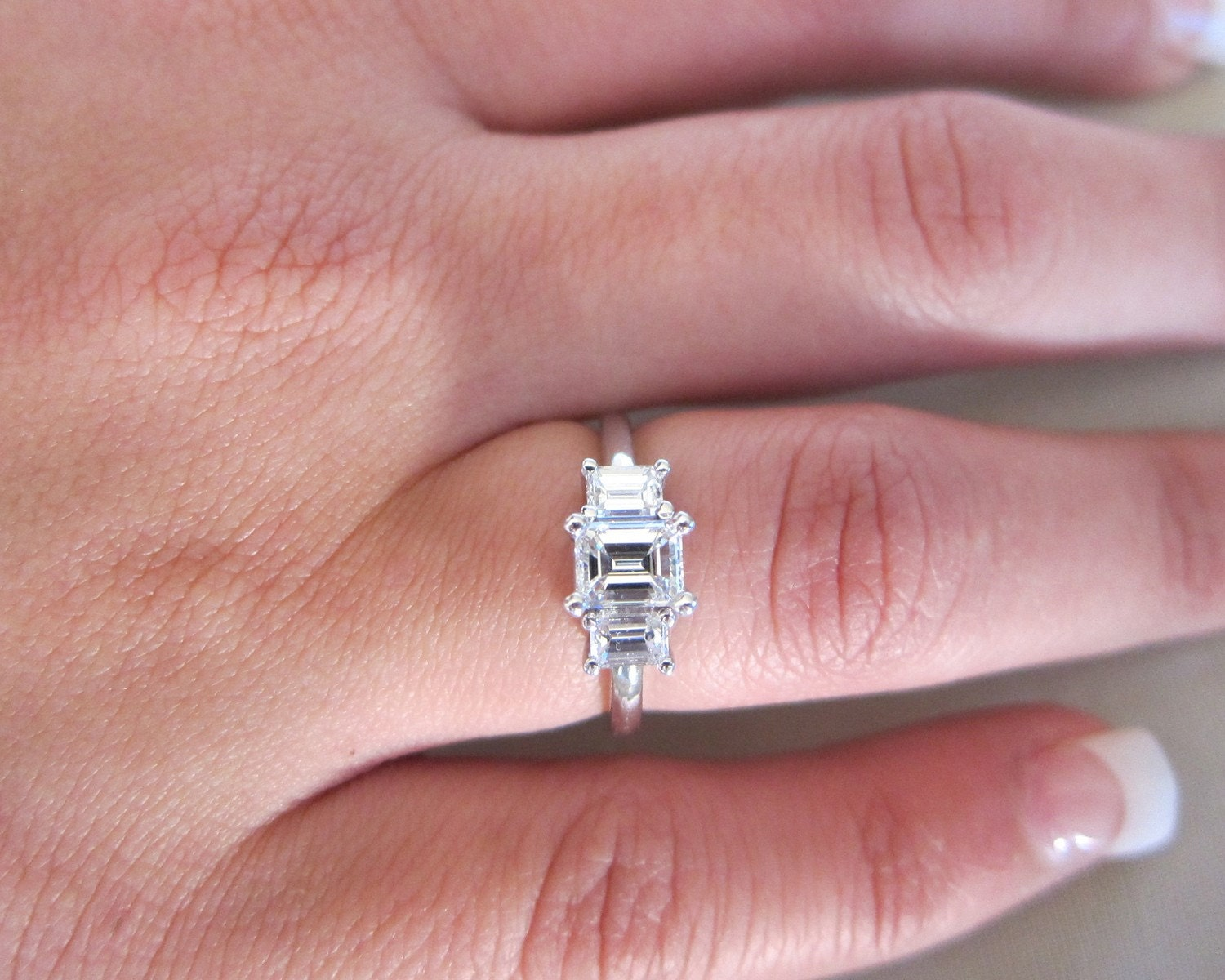 three stones emerald cut platinum engagement ring