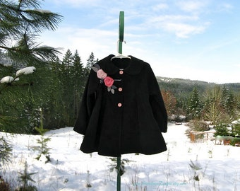 Black swing coat for girls embellished with handmade pink roses and silver leaves. Classic style