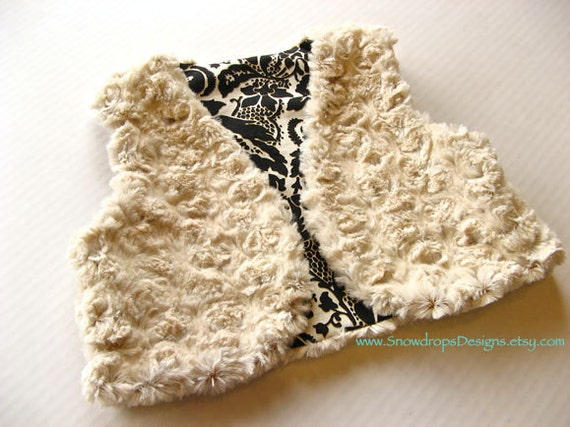 Girls' reversible faux fur vest. Black and ivory damask and creamy fur.