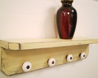 Shabby Chic wall shelf, French Country, Distressed, Primitive Wooden Wall Shelf with 4 Antique Ceramic Knobs- in Creamy Yellow