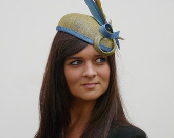 Unique handmade sinamay hat with parot feathers Dutch couture on aliceband