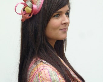 A made to order fascinator on aliceband, with your own matching fabric, feathers and sinamay